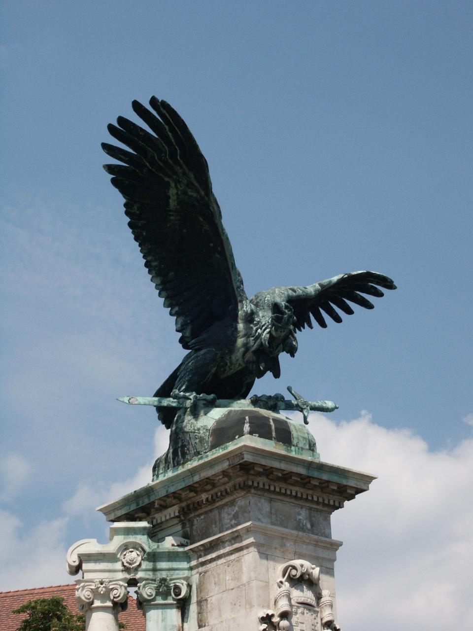 a sculpture of the mythical turul bird that guards the palace the